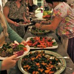 Some of the 30 guests at the vegan feast tuck in with Renee serving them, too.